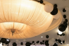 Black and white balloons line the chandelier at our 2018 Black and White Ball!